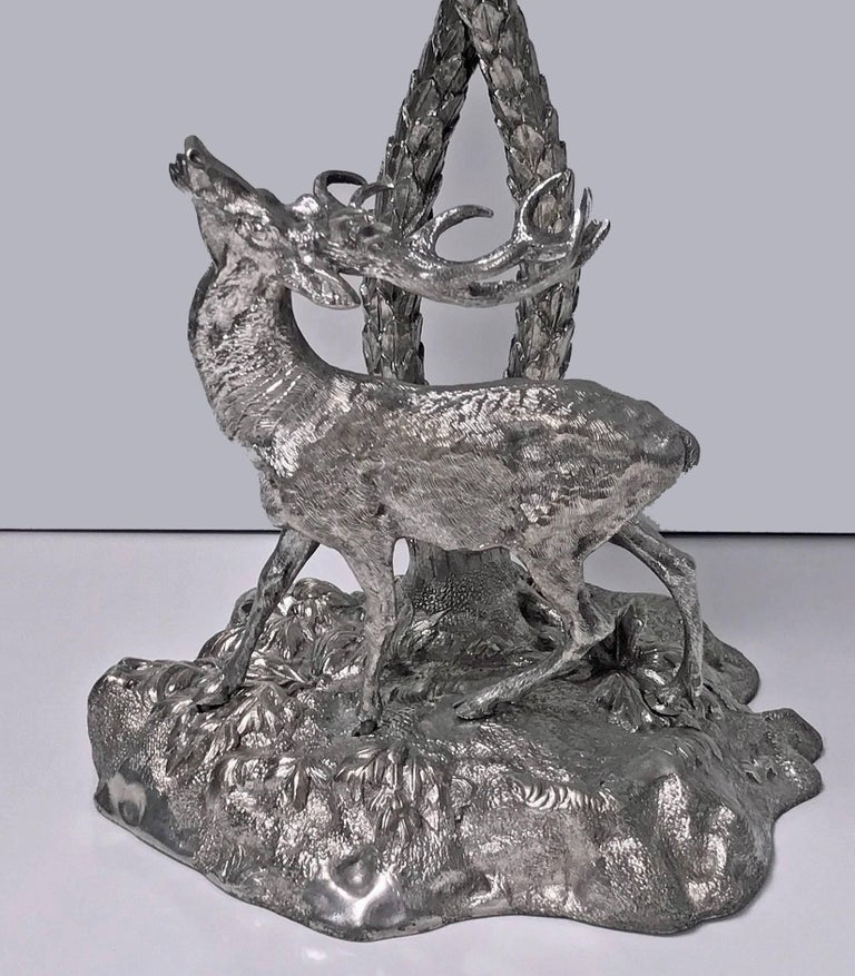 19th century Victorian Elkington style centrepiece, English, circa 1870. Silver-plated bronze cast in the form of a deer gazing up at palm trees. Measures: 17.00 (height) x 11.00 (breadth) x 7.00 (base) inches.