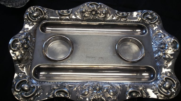 Beautifully detailed 19th century inkwell. Signed on the tray JD&S Company. Nice details on the tray accompanied by two cut crystal inkwells with silver plated tops. A beautiful decorative piece.