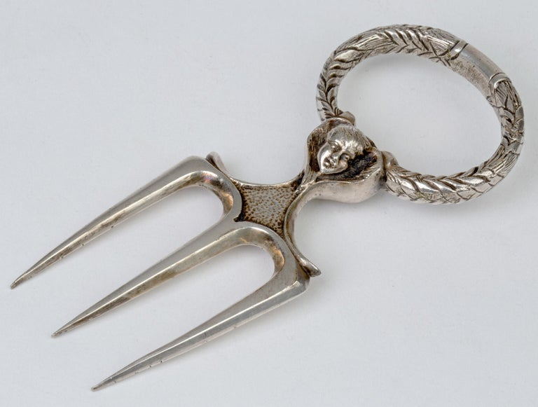 19th Century Antique Silver Plated Three Pronged Bread Fork with Angelic Heads For Sale