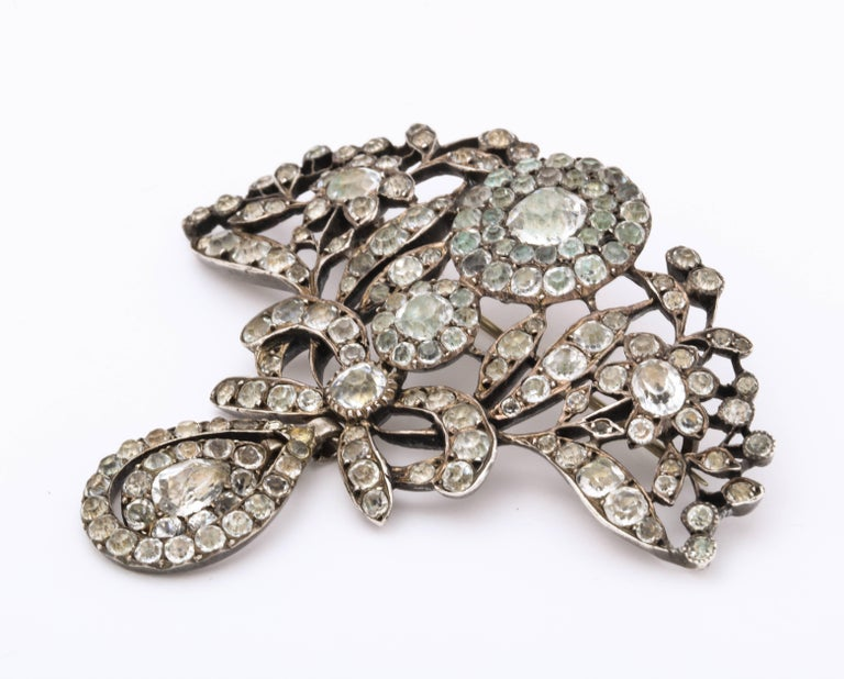 From my personal collection, a pendant brooch of Black dot paste of every shape and size is set in rounded pillow back foiled sterling, made in Portugal where, together with France, the finest paste jewelry was created in 1800 and earlier. The