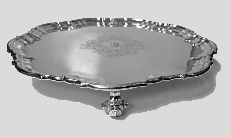 Antique silver salver, London 1892 Edward Hutton William Hutton and Sons. The George 11 style Salver on three acanthus ball supports, circular shape and moulded border, engraved central cartouche with initial C. Diameter: 10.25 inches. Weight: 23.75