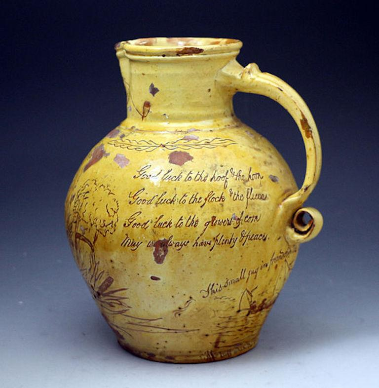 A good earthenware slip glaze scraffito decorated harvest pitcher named and dated
