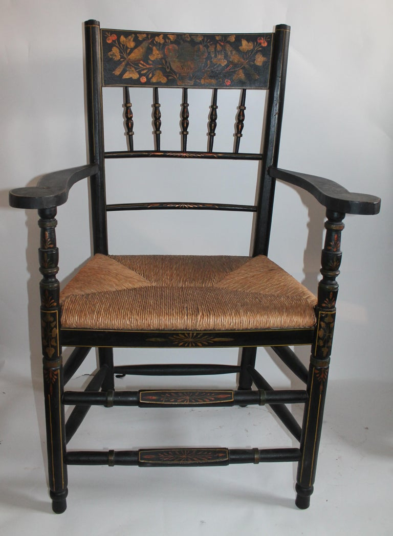 This 19th century made in Spain hand decorated and painted arm chair is in fine condition. Signed by the artist and maker. Hand woven seat.
