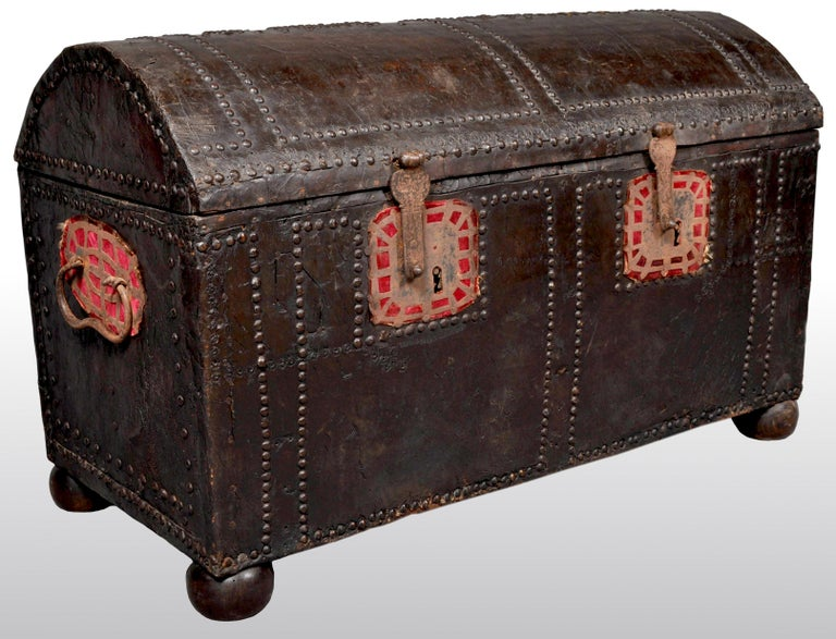 Antique Spanish baroque leather and studded wedding trunk / coffer, circa 1700. The trunk having a domed top and decorated with panels of studwork, this decoration is repeated on the front and sides. The trunk having iron strapwork handles to each