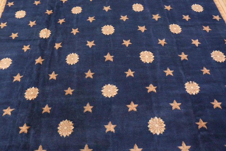 Celestial star design square size antique Spanish carpet, Country of origin: Spain, circa 1920. Size: 11 ft 5 in x 12 ft 9 in (3.48 m x 3.89 m)  The elegantly simple design featured throughout this carpet does not take away from its charming