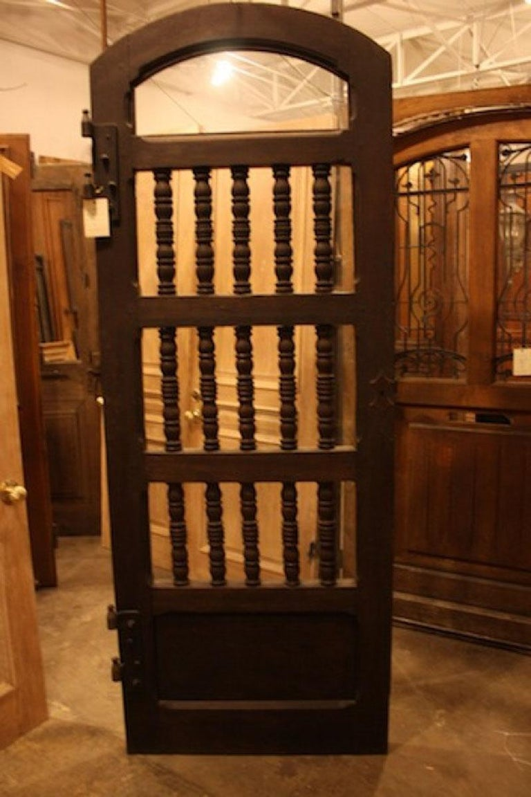 This antique garden entry door features over sized spindles and glass panels. The door was originally the entry door to a rose garden in Spain. Glass has been added so this will be perfect for any entry or wine room as well!  Origin: