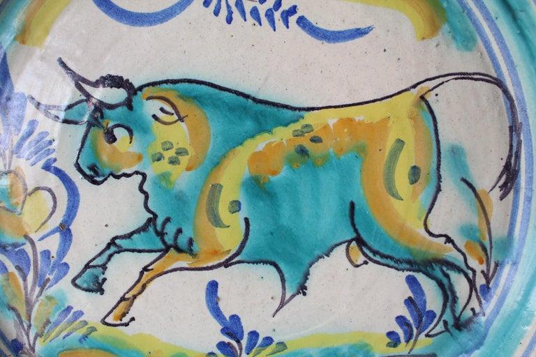 19th century Spanish Majolica wash basin. Painted bull.