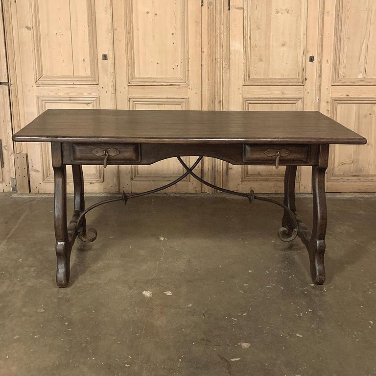Antique Spanish writing desk is shallow enough to place behind a sofa, or to use as one's primary home office desk, and even as an executive desk at the casual oriented office! Classic lyre-shaped legs with hand forged wrought iron stretchers