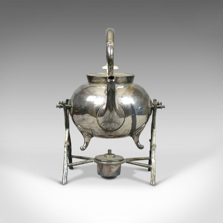 This is an antique spirit kettle on stand. A decorative silver plated tea pot on stand dating to the early 20th century.  An attractive spirit kettle on stand Double fulcrum stand provides 'on stand' pouring Beautifully crafted and