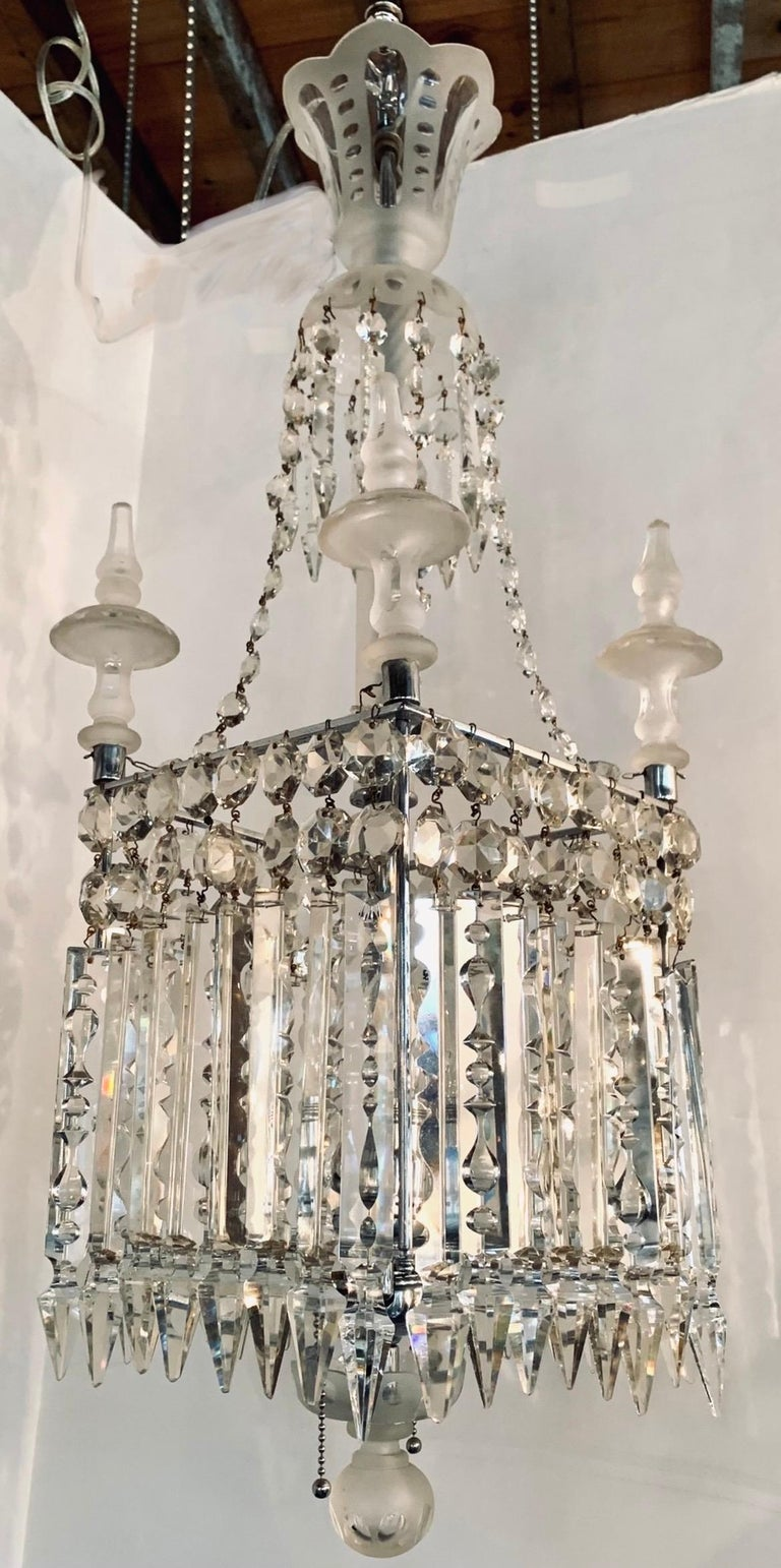 Stunning chandelier features a cube shaped body with frosted etched glass spires and long dangling crystals on all four sides. Takes two bulbs. Wired and in working condition.