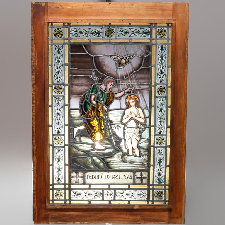 An antique leaded and painted pictorial stained glass window titled