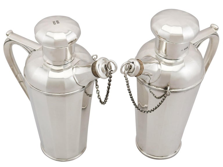 An exceptional, fine and impressive composite pair of antique George V English sterling silver cocktail shakers made in the Art Deco style; an addition to our wine and drinks related silverware collection.  These exceptional antique cocktail
