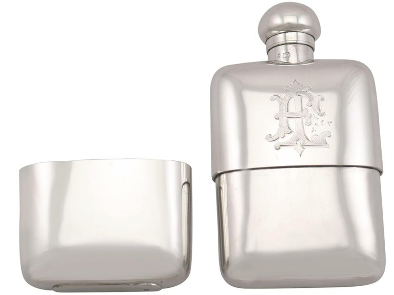 An exceptional, fine and impressive, antique George V English sterling silver hip flask fitted to its original box; an addition to our wine and drinks related silverware collection.  This exceptional, fine and impressive antique George V sterling
