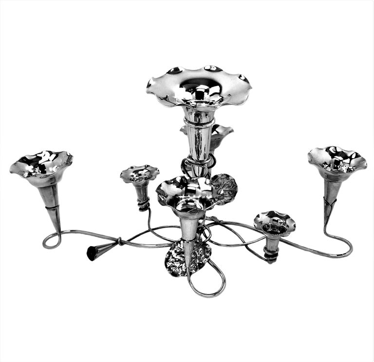 A beautiful Antique solid Silver Epergne in an elegant trailing flower design with 7 trumpet Vases arranged as stylised flowers on the branches of the centrepiece.   Made in Sheffield, England in 1910 by Mappin & Webb.  Approx. Weight - 1112g /