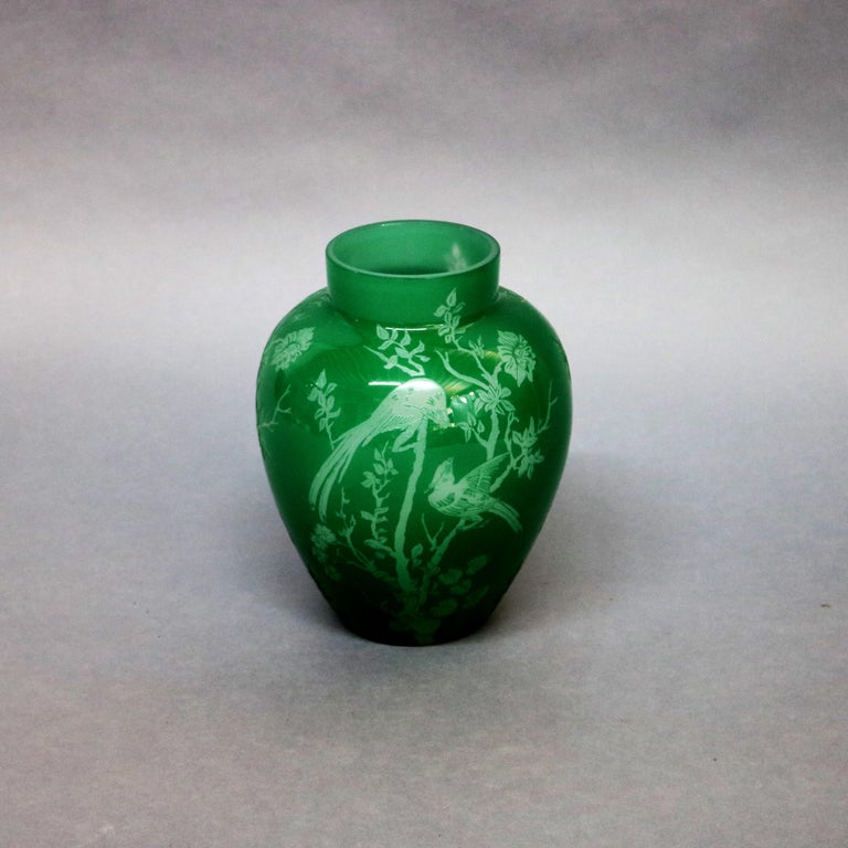 Steuben art glass vase features jade green over alabaster cutback in the Bird of Paradise pattern, circa 1930  Measures: 9