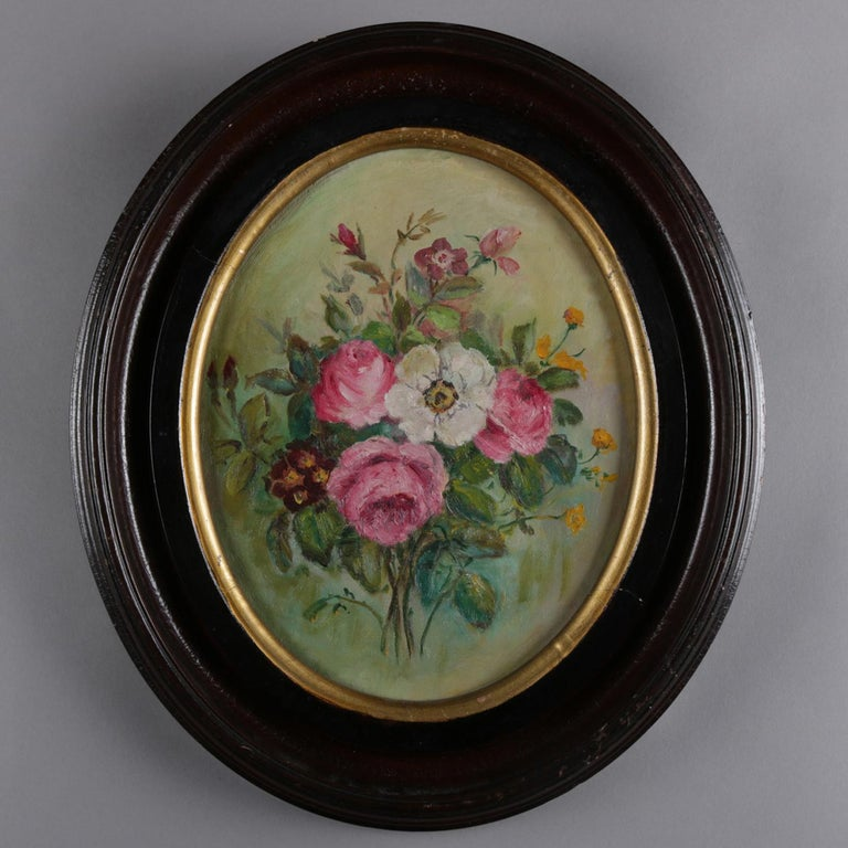 An antique still life oil on canvas over artist board painting depicts flowers in bouquet, seated in oval deep walnut frame, circa 1890  ***DELIVERY NOTICE – Due to COVID-19 we are employing NO-CONTACT PRACTICES in the transfer of purchased items.