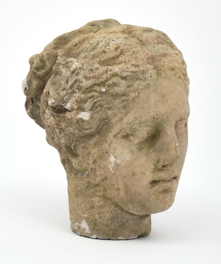 Antique stone bust of Athena. This piece made of reconstituted stone takes the form of Greek goddess Athena. We love the details of this interesting piece.