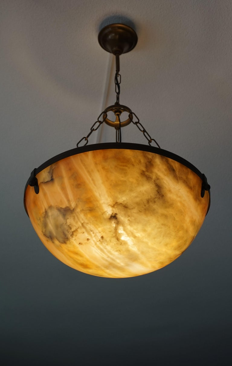 Stylish and excellent condition alabaster in brass frame light fixture.  If you are looking for a beautiful and stylish light to grace your living space then this early 1900s, mineral stone pendant could be the one. All handcrafted in the Arts &