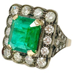Antique Style Emerald and Diamond Engagement Ring in 18 Karat Gold