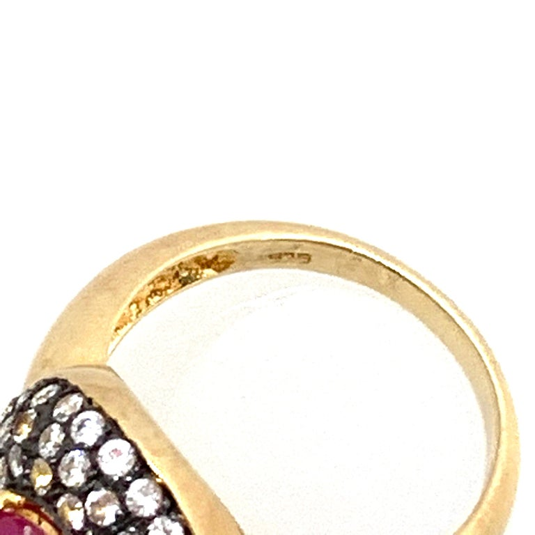 Women's or Men's Antique-style Oval Ruby and White Topaz Bombe Cocktail Ring For Sale