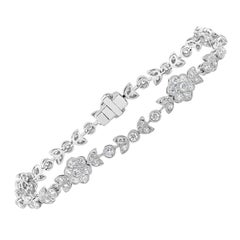 Antique-Style Round Diamond Flower Tennis Bracelet