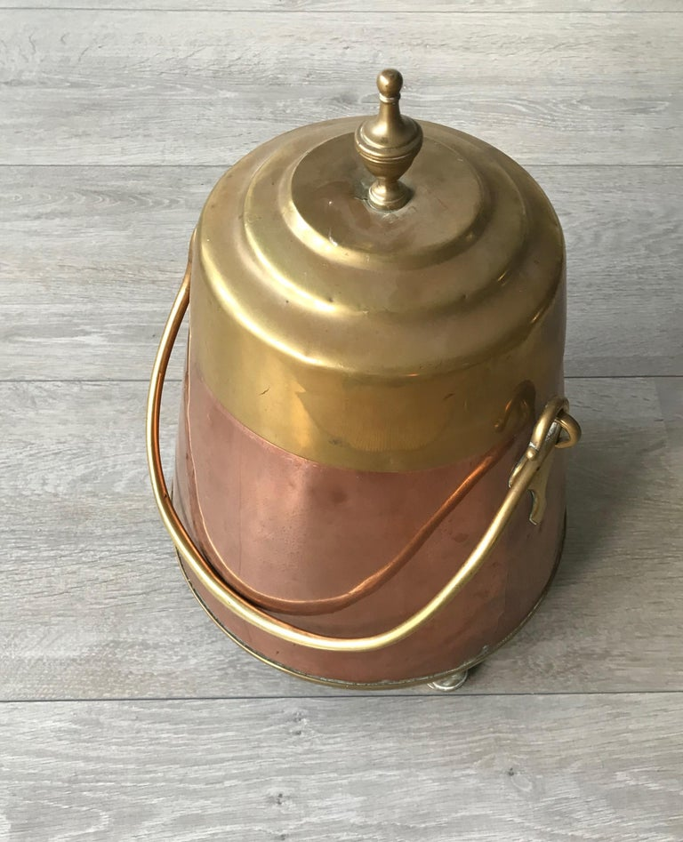 An elegant and very decorative copper fire place tool from the 1800s.  This handcrafted, copper and brass kettle could only be afforded by the very well-to-do in the 1800s in Europe and in the Netherlands in particular. It would have taken a highly
