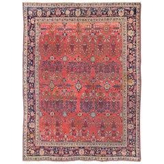 Antique Sultanabad Carpet with Large Scale Flowers Set Atop a Red Field