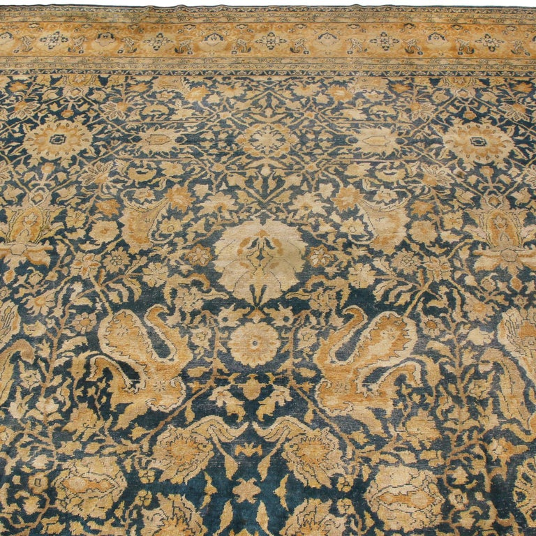 Originating from Persia between 1880-1890, this hand knotted antique Sultanabad rug was crafted with particularly luminous, soft wool complementing both inviting colourways and patterns. Hailing from weavers in the mountains, this combination of