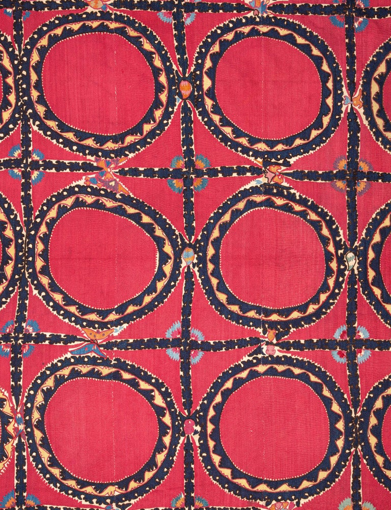 An antique Suzani with interesting details. Lined with linen.