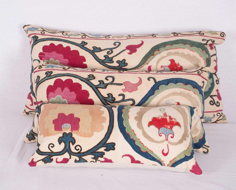 The pillow cases are made from an antique Uzbek Suzani from Bukhara. It is silk embroidery on a handwoven cotton field. The backing is pure linen, and they do not come with inserts but bags made to the size in cotton to accommodate insert materials.