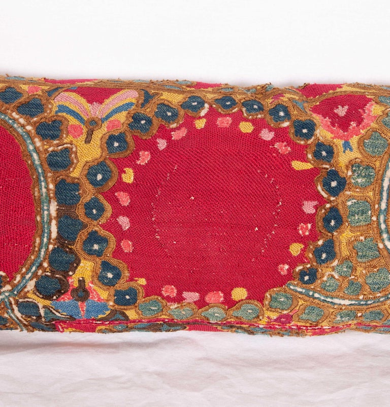 The pillow case is made from an antique Uzbek Suzani from Tashkent . It is silk embroidery on a handwoven cotton field. The backing is pure linen, and it does not come with an insert but bag made to the size in cotton to accommodate insert