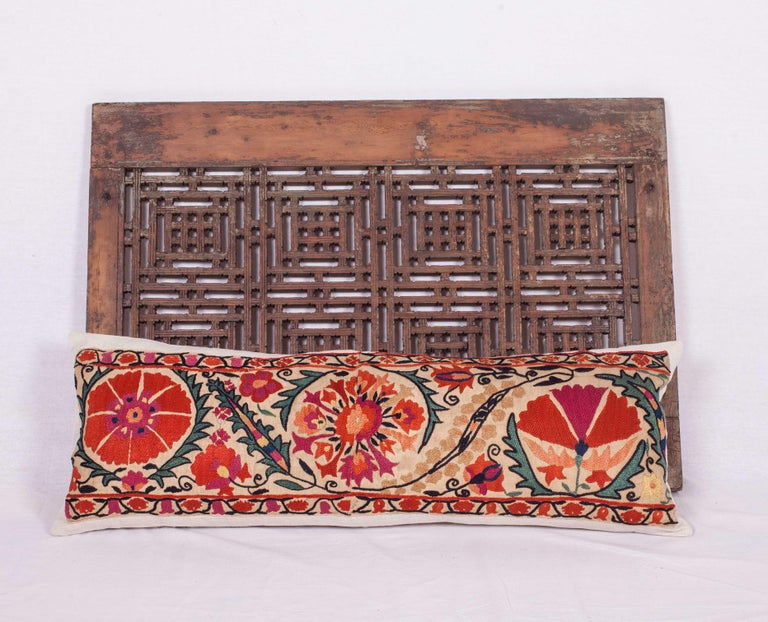 An excellent antique Suzani pillow made from the border of a mid-19th century or earlier Nurata Suzani. (Suzani fragment has been appliquéd on linen professionally and then converted into a pillow case so the embroidery is still intact just incase
