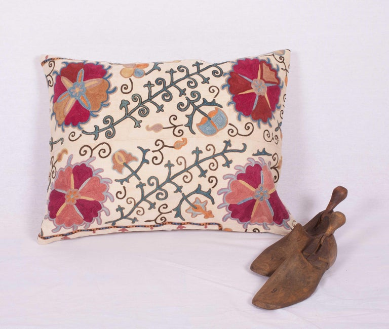The pillow case is made from an antique Uzbek Suzani from Bukhara. It is silk embroidery on a handwoven cotton field. The backing is pure linen, and they do not come with inserts but bags made to the size in cotton to accommodate insert materials.