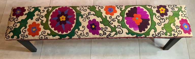 Exceptional sitting bench made of solid wood, no nails flat black painted, professionally upholstered with beautiful all hand embroidery 19 century Suzani textile. What a fantastic object of art for use and display, structurally excellent.