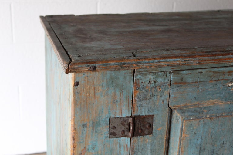 18th century Swedish cupboard with blue paint. It has a two-door front, with 2 shelves inside. Original working lock and key.