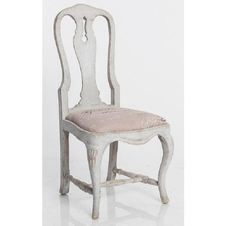This set of six antique dining chairs are in the Swedish Rococo style. Recently reupholstered.