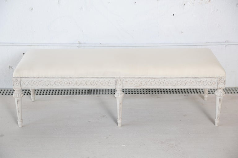 Antique Swedish Gustavian style painted six-leg bench antique Swedish style white painted six-leg bench with upholstered top.