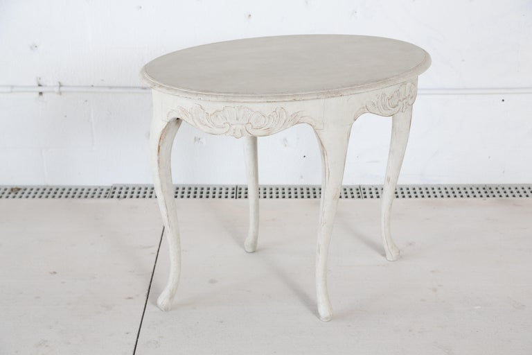 Antique Swedish Rococo style painted oval table, painted in Swedish white finish. Lovely scalloped