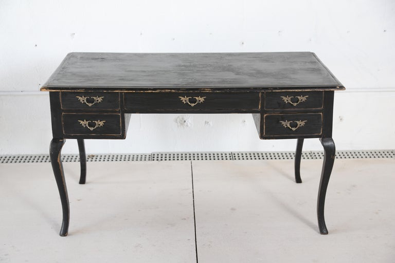 Antique Swedish Rococo Style writing desk in Black distressed paint finish , cabriole legs, five drawers with lovely carved brass hardware, simple half round top edge.  H 29