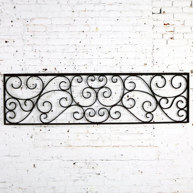 Gorgeous antique swirled design piece of wrought iron. It is, and was originally, a railing piece but could be used as a fence section, a trellis or wall-hanging art piece. It is in wonderful antique condition with lots of age patina, circa