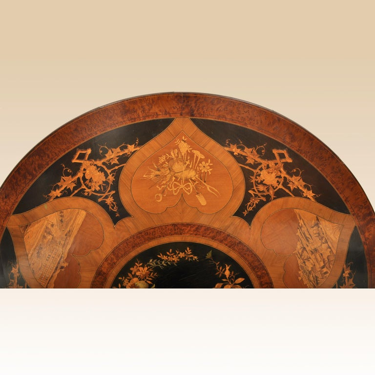 Ebony Antique Swiss Black Forest Tilt-Top Pedestal Walnut Marquetry Carved Table, 1880 For Sale