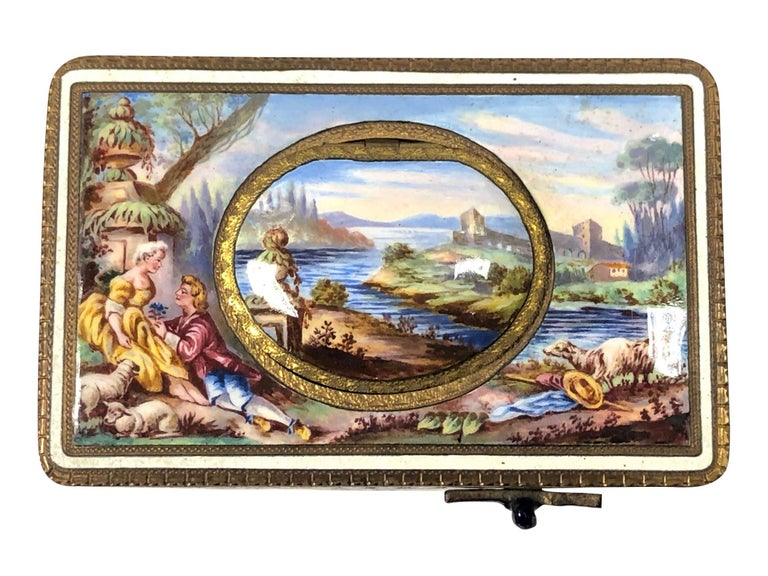 Circa 1930s Bird Box Music Box, Enamel On Gilt Brass with a scenic depiction on the top, the box measures 4 X 2 1/2 X 1 3/4 inches. Mechanical spring wind movement that operates a Feathered covered Bird that through a series of mechanics is revealed