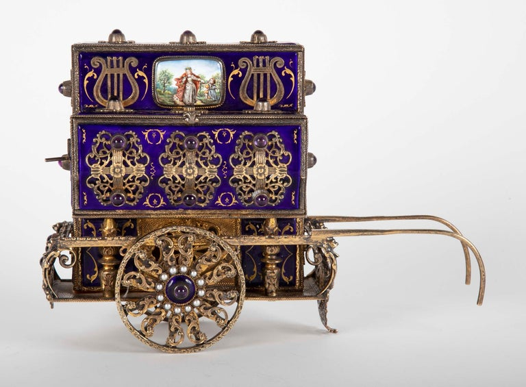 Charles Reuge enamel on sterling silver Swiss antique box in the form of an Organ Grinder's Cart. This piece is one of the rarest of his works using the finest materials including real pearls, sterling silver and cabochon amethyst. Marked Reuge.