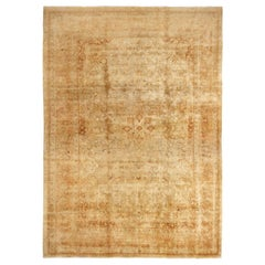 Antique Tabriz Beige and Cream Wool Persian Rug with Light Distress