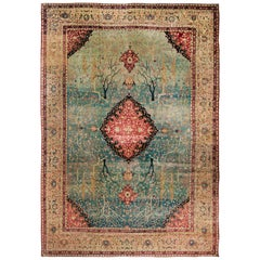 Antique Tabriz Red and Blue Wool Persian Rug