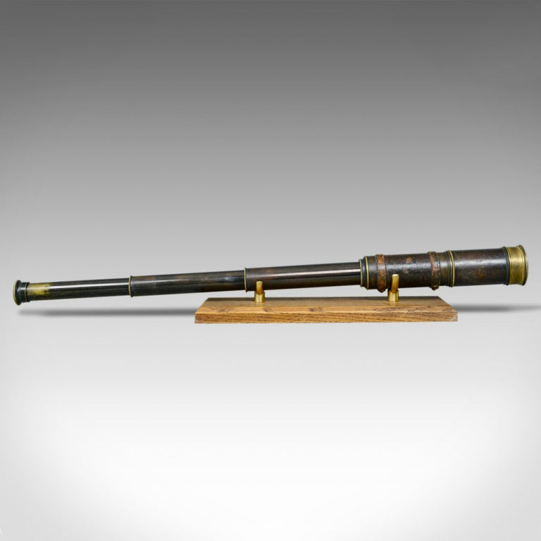 This is an antique telescope, a three draw refractor for terrestrial or astronomical use. An English, Victorian spotter scope dating to circa 1880.