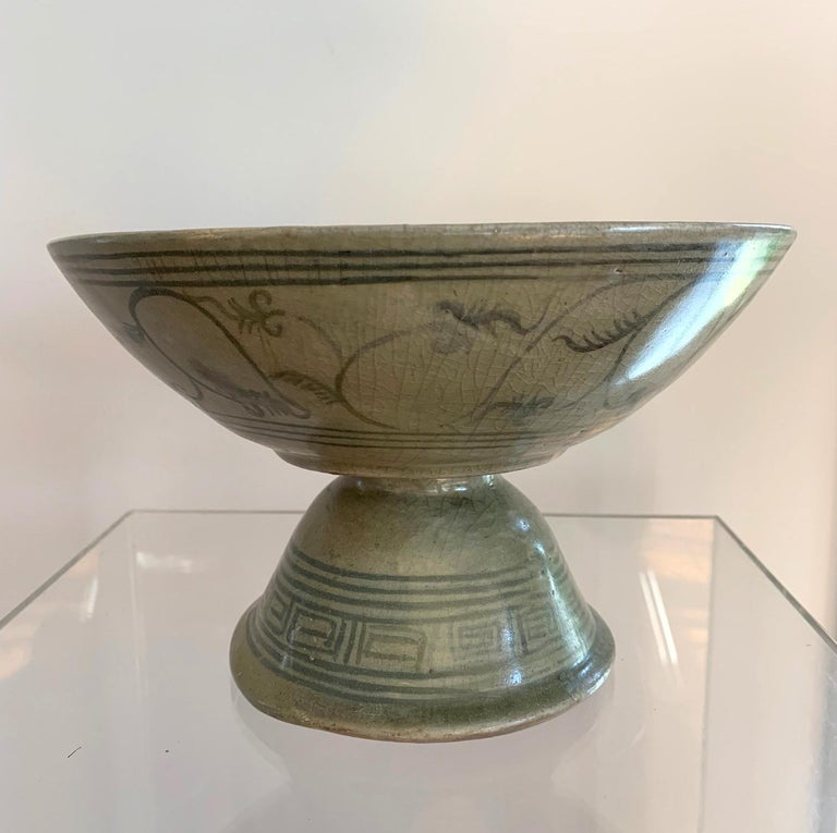 A celadon stemmed dish with underglaze deep blue decoration from Sukhothai (a former Kingdom in nowadays central Thailand) circa 14th-16th century. The pedestal dish was a typical ceramic output from Sawankhalok region, likely one of the kilns in