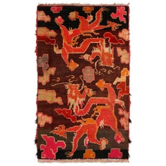 Antique Tibetan Orange and Brown Wool Rug with Dragon and Cloud Motifs