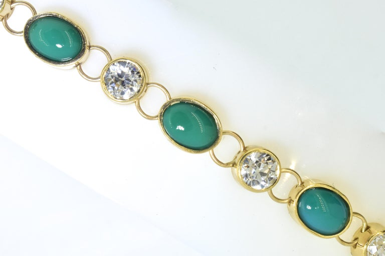 Tiffany & Company 18K yellow gold bracelet set with fine old European cut diamonds and natural turquoise.  The 6 diamonds are all well matched in cut and symmetry.  They are near colorless, (H,I) and very slightly included (VS).  There is an