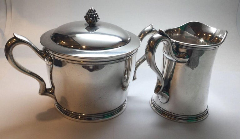 Antique sterling silver lidded double handle sugar bowl and creamer by Tiffany & Co. Berry finial on sugar bowl lid  Circa 1880 - 1881 according to pattern #5962  Scrolled monogram ALC June 8th, 1881  Total weight 944.2 grams, 607.1 penny